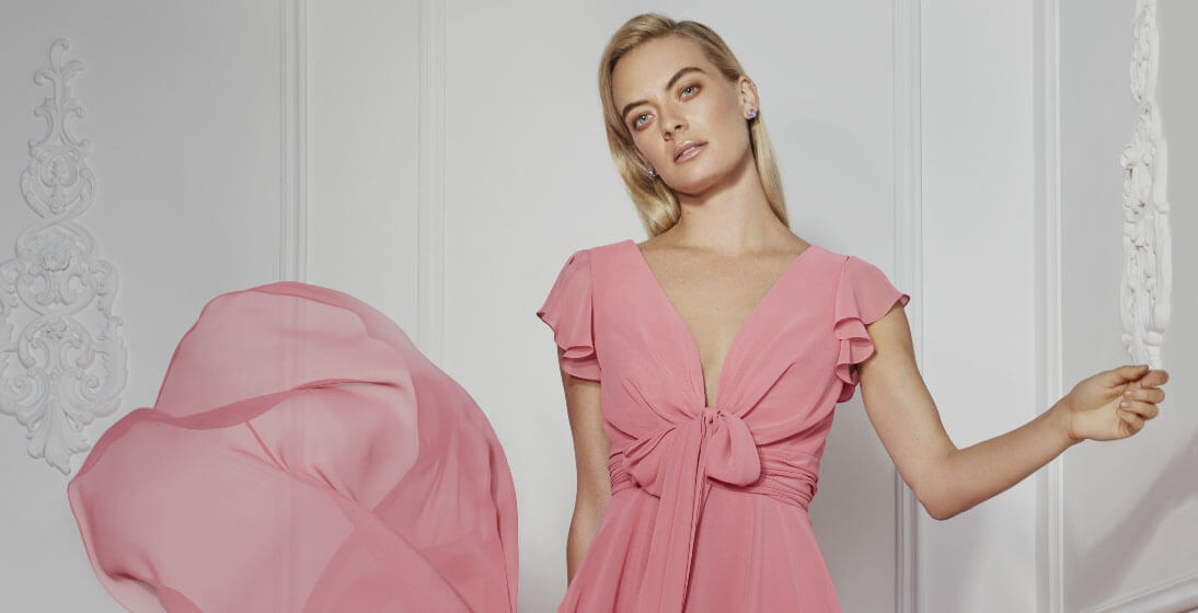 Model wearing a pink evening dress